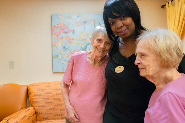 Memory care residents talking to caregiver